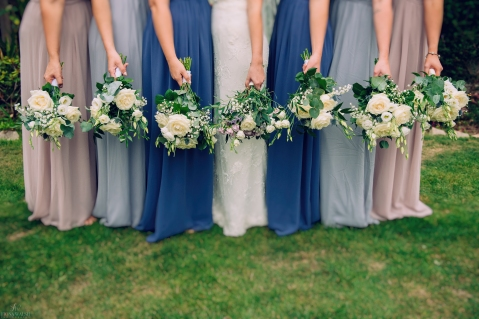 Love the colours of the bridesmaid dresses. Bridesmaids all had white and foliage bouquets. The Bride's bouquet complimented the bridesmaid dresses with lilac, grey/blue and pink