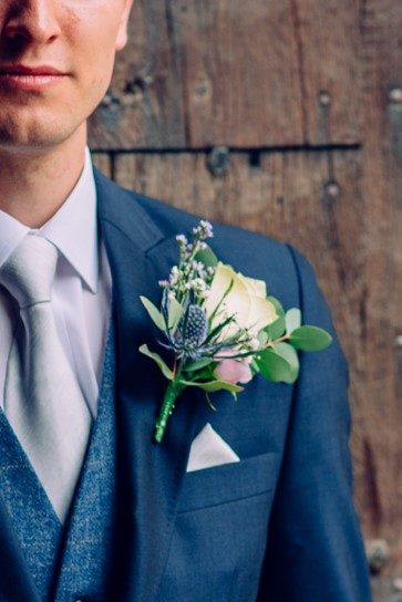 The Groom's boutonniere reflected the lovely flowers in the Brides bouquet