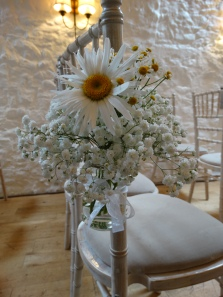 Lovely Daisy and Gypsophila chair decorations