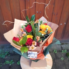 A Thank you bouquet in red and gold
