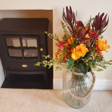 A vibrant bouquet in rich gold, orange and red