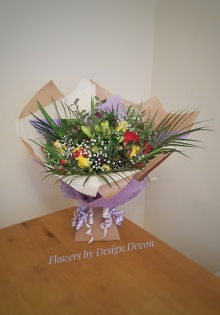 Bright and cheerful Hand tied Birthday Bouquet in an Aqua Pack £45.