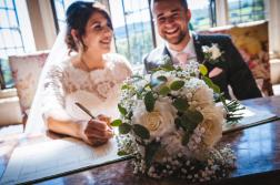 Stunning couple with Bride's bouquet. Photography by Dean Elliott